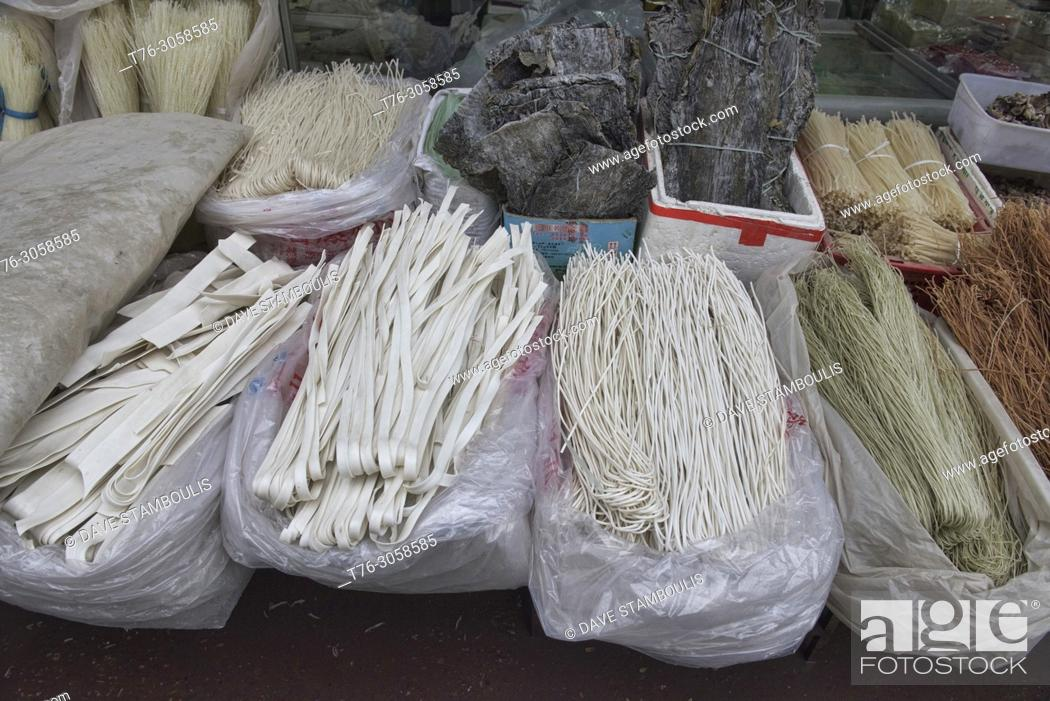 Stock Photo: A variety of handmade noodles for sale at the market in Dunhuang, Gansu, China.