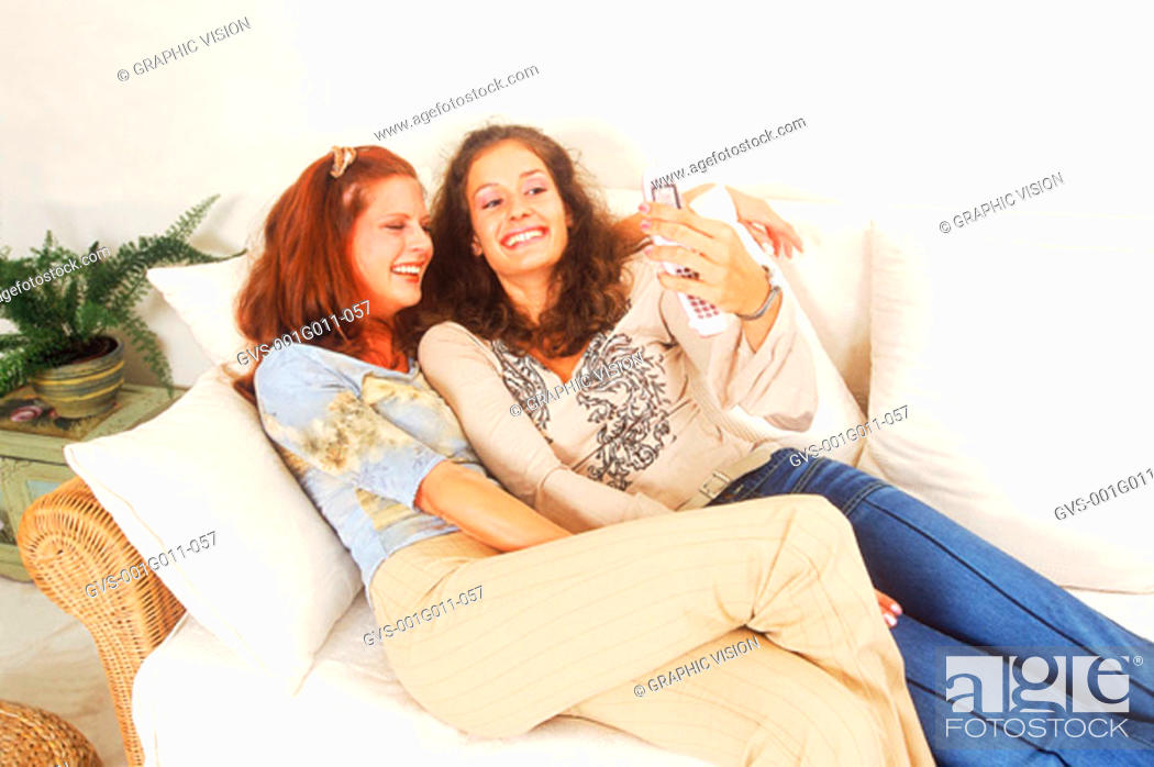 Stock Photo: Two young women playing with a mobile phone.
