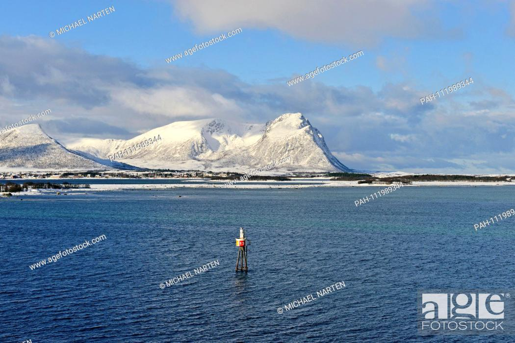 Stock Photo: A sea mark in the blue water of the Risøysound in front of the snow white Vesterålen Island Andøya, 10 March 2017 | usage worldwide.