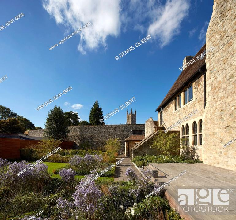 Stock Photo: View through garden with Grade II listed building by William Butterfield and boundary wall. Kingsdown House, King's Canterbury, Canterbury, United Kingdom.