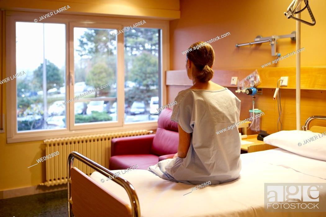 Stock Photo: Patient in hospital room. Hospital Policlinica Gipuzkoa, San Sebastian, Donostia, Euskadi, Spain.