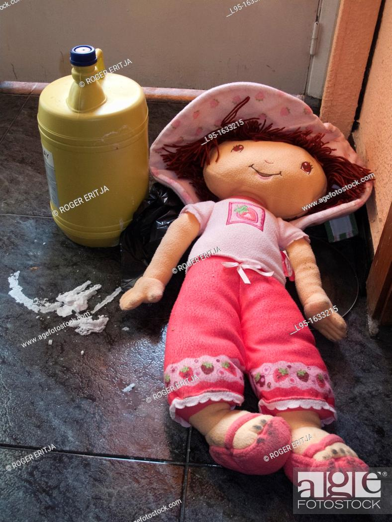 Stock Photo: Abandoned doll in an empty house besides a leaking bleach bottle.