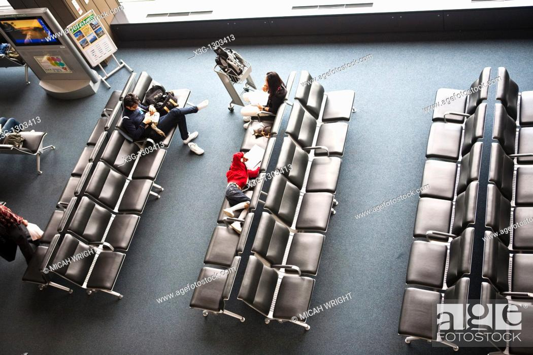 Stock Photo: Resting and waiting for a flight in a lounge at Japan's Narita airport.