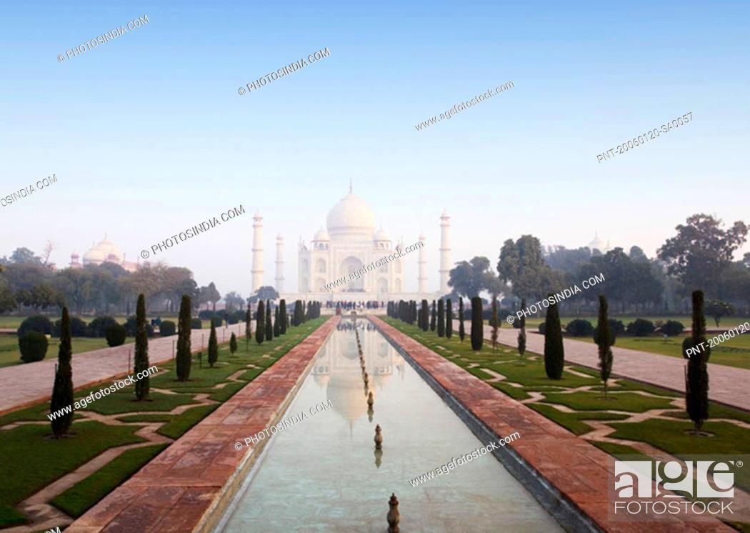 Stock Photo: Reflection of a mausoleum in the pond, Taj Mahal, Agra, Uttar Pradesh, India.