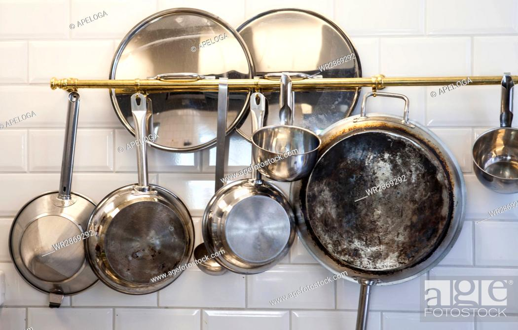 Photo de stock: Kitchen utensils hanging in kitchen.