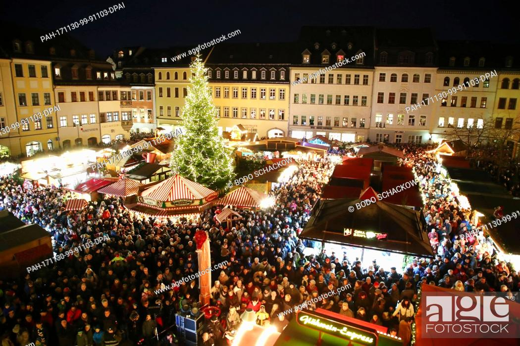 Stock Photo: Visitors walk across the Christmas market during the opening of the 'Gera Fairy Tale Market' in Gera, Germany, 30 November 2017.