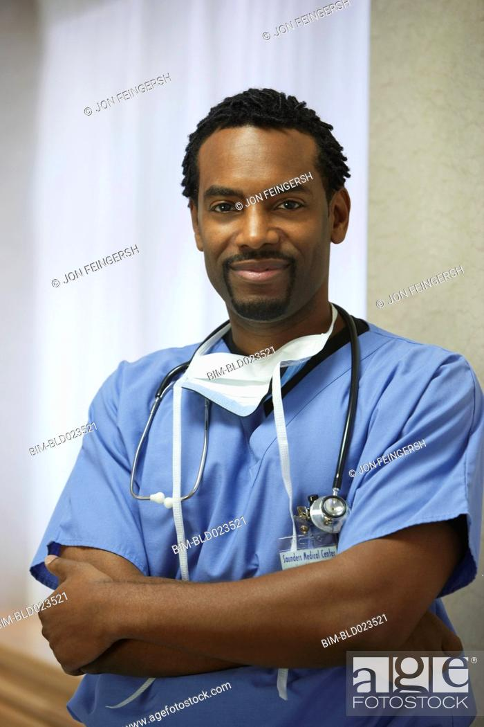 Stock Photo: African male surgeon with arms crossed.