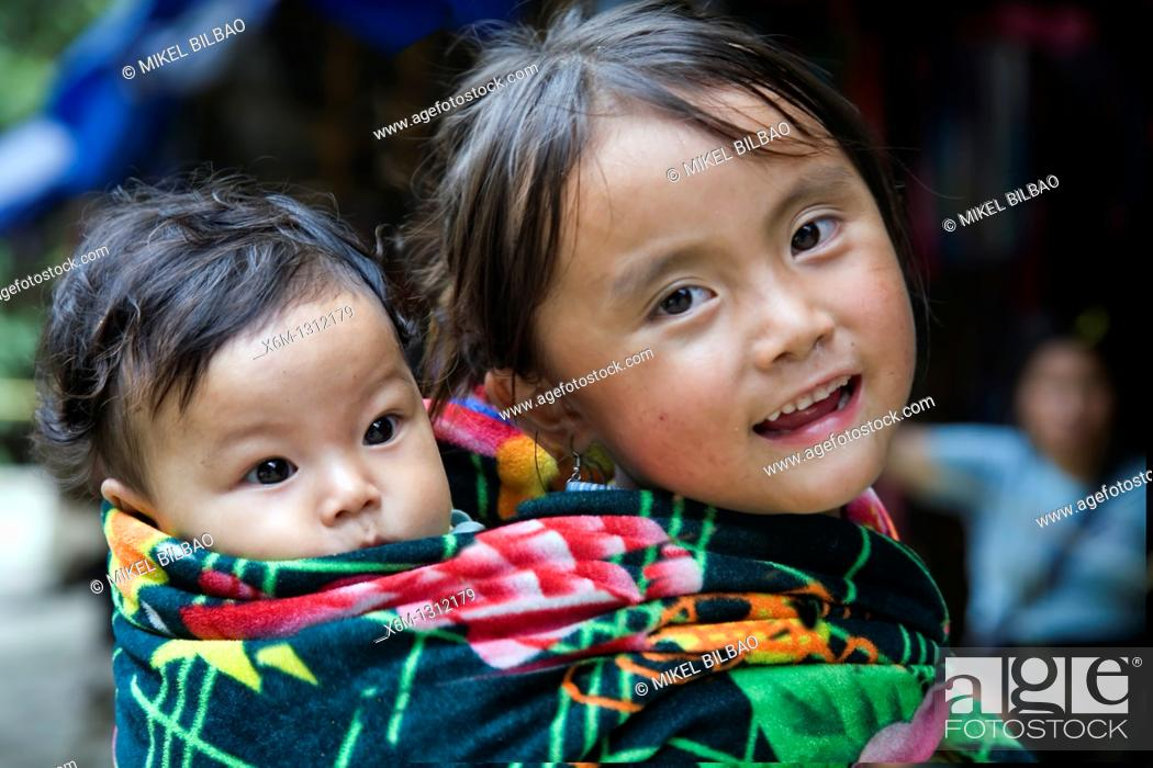 Stock Photo: little girl and brother in Cat Cat village  Sapa, Lao Cai province, Vietnam.