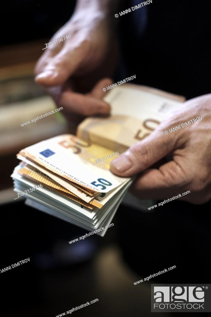 Stock Photo: Counting cash-euro banknotes-selective focus.