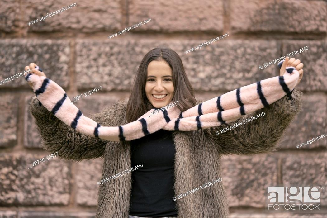 Stock Photo: fashionable woman playing with scarf, happy laughing, in Munich, Germany.