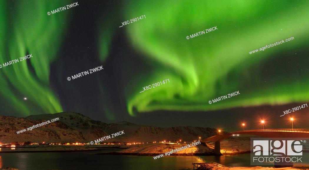 Stock Photo: Northern Lights over the bridges of Fredvang (Fredvangbruene) connecting the islands Moskenesoya and Flakstadoya. The Lofoten Islands in northern Norway during.
