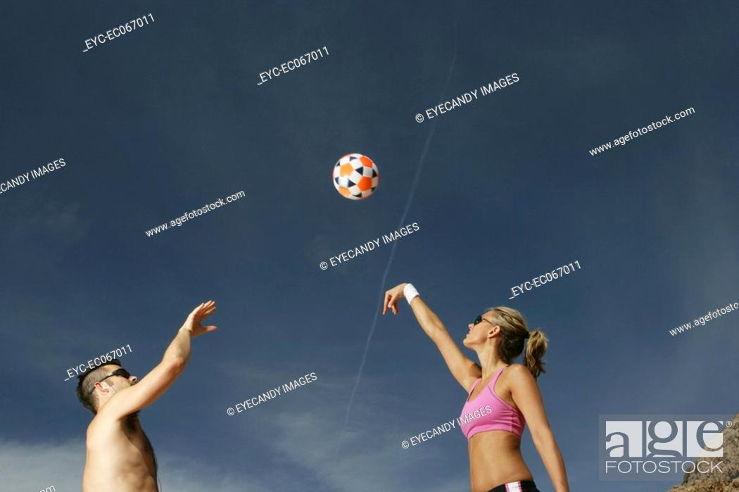 Stock Photo: Couple playing Volleyball.