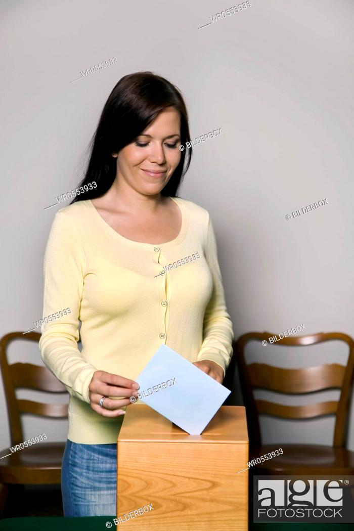 Imagen: A young woman at elections in the voting booth.Voting in a democracy.