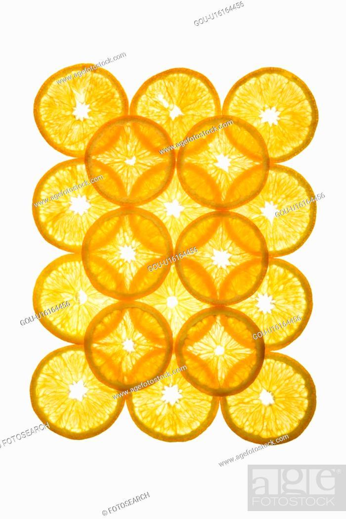 Stock Photo: Orange slices arranged in design on white background.