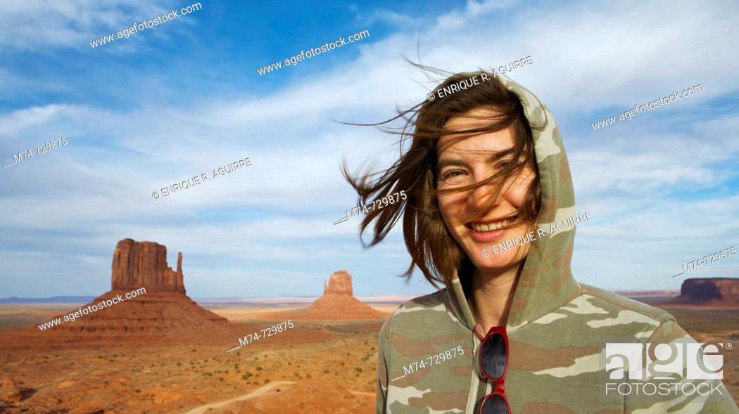 Stock Photo: Young woman tourist at Monument Valley Navajo Tribal Park, Arizona & Utah, USA.