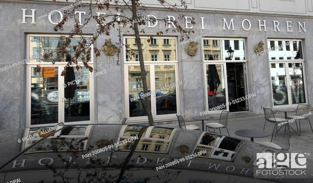 Stock Photo: 05 August 2020, Bavaria, Augsburg: In Maximilianstraße, the name is written on the facade of a hotel. After years of discussions about the hotel name.