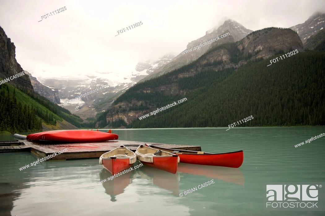 Stock Photo: Canoes on Lake Louise, Banff National Park, Alberta, Canada.