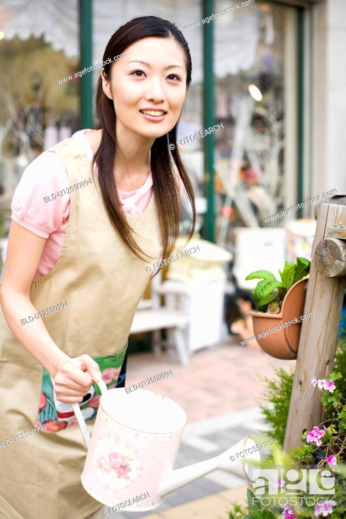 Stock Photo: Woman at the flower shop.