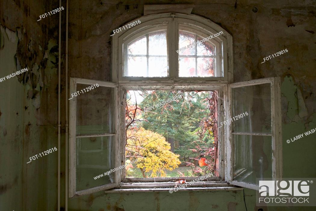 Stock Photo: An open window in an abandoned building, Beelitz-Heilstaetten, Germany.