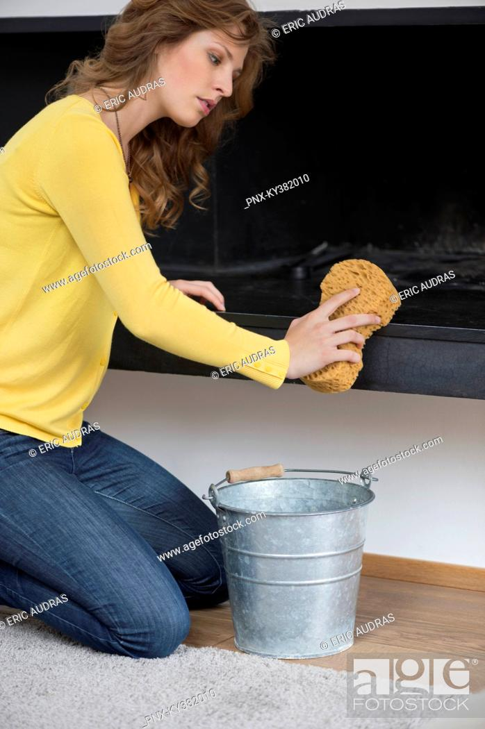 Stock Photo: Woman cleaning fire place.