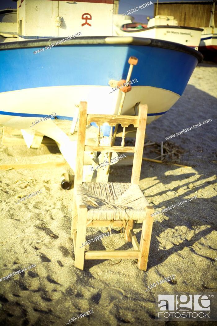 Stock Photo: Chair and boat, Cabo de Gata, Almeria, Spain.