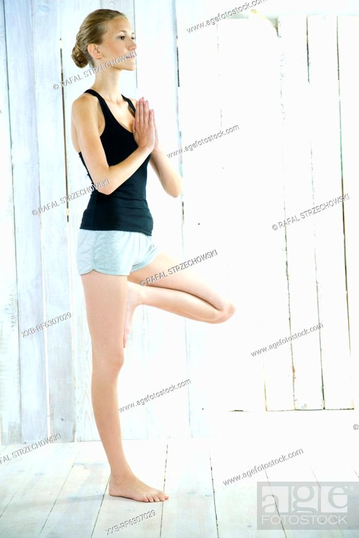 Stock Photo: young woman doing yoga.