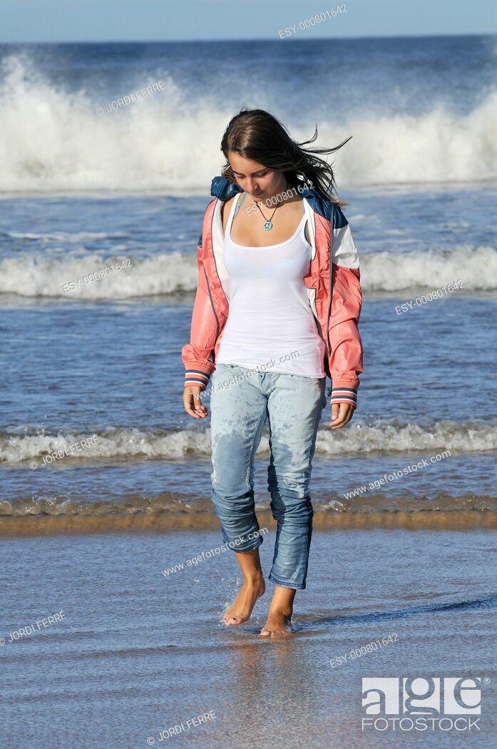 Stock Photo: Girl walking at beach, Lossiemouth, Moray, Scotland, United Kingdom, Europe.