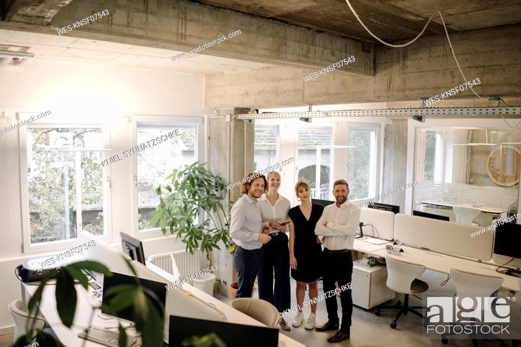 Stock Photo: Happy bussiness team standing in office.