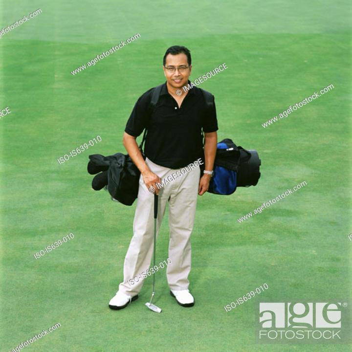 Stock Photo: Portrait of a male golfer.