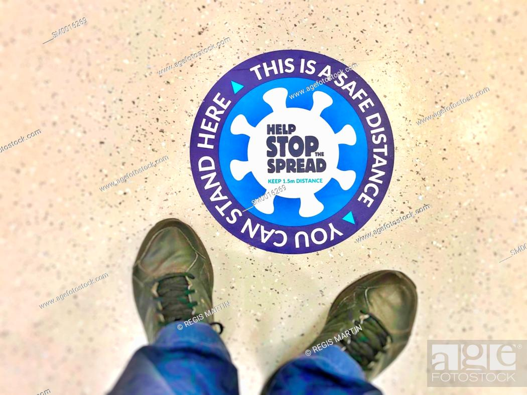 Stock Photo: Marking on the floor to respect social distancing to stop the spread of Covid19, the corona virus.