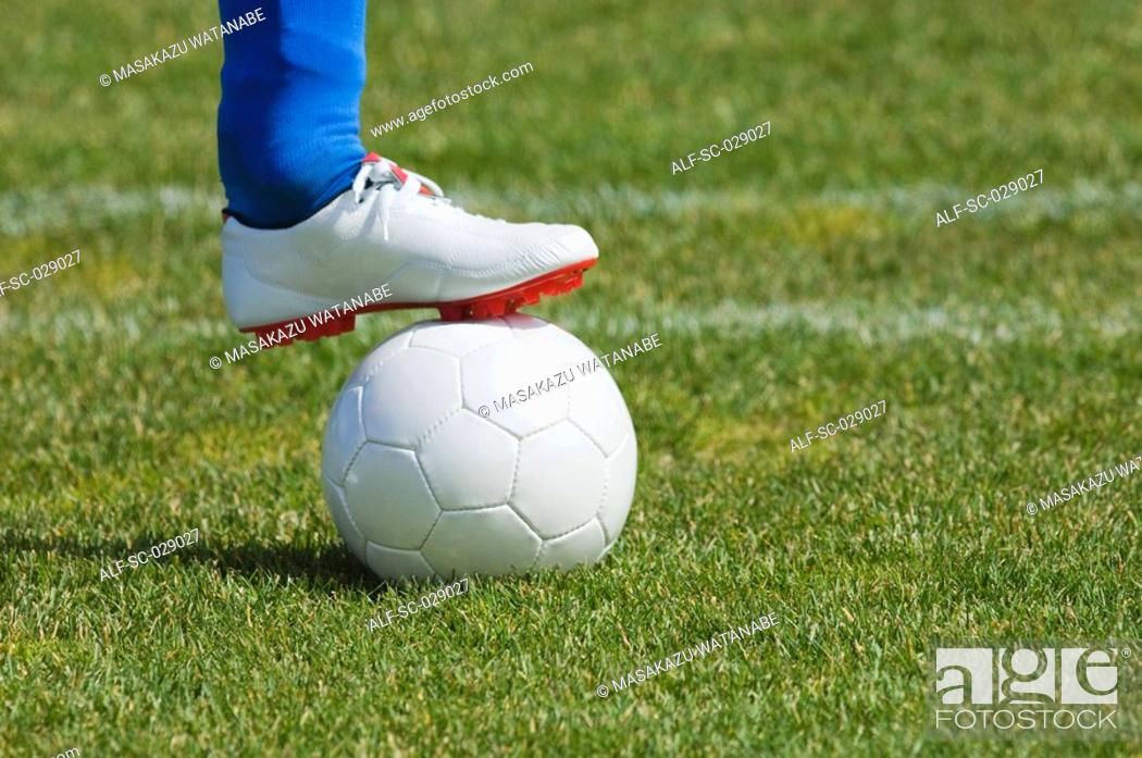 Stock Photo: Soccer Player Holding Ball.