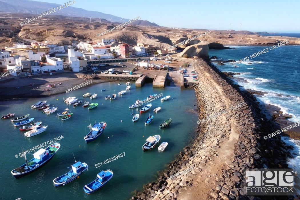 Stock Photo: Aerial view of a little fishing town with some colorful boats in Tajao, Tenerife, Canary Islands. High quality photo.