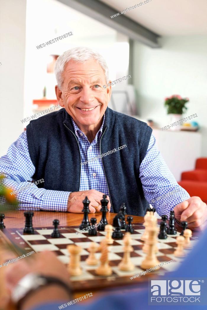 Stock Photo: Germany, Leipzig, Senior men playing chess game.