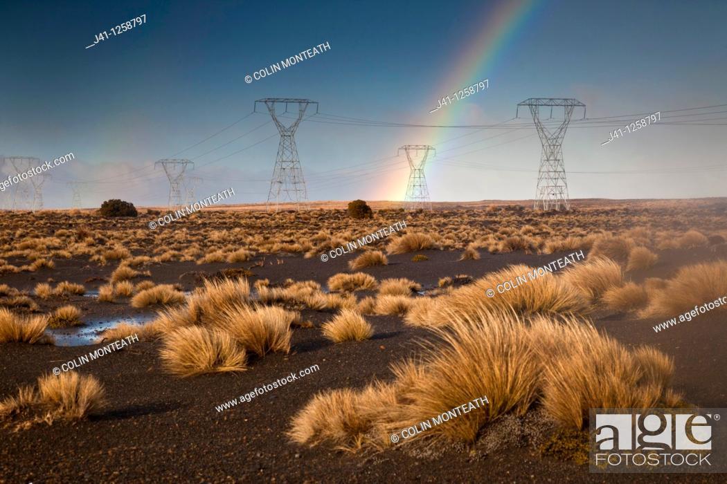 Stock Photo: Rainbow over power plyons, Rangipo desert near Mt Ruapehu, Tongariro National Park.