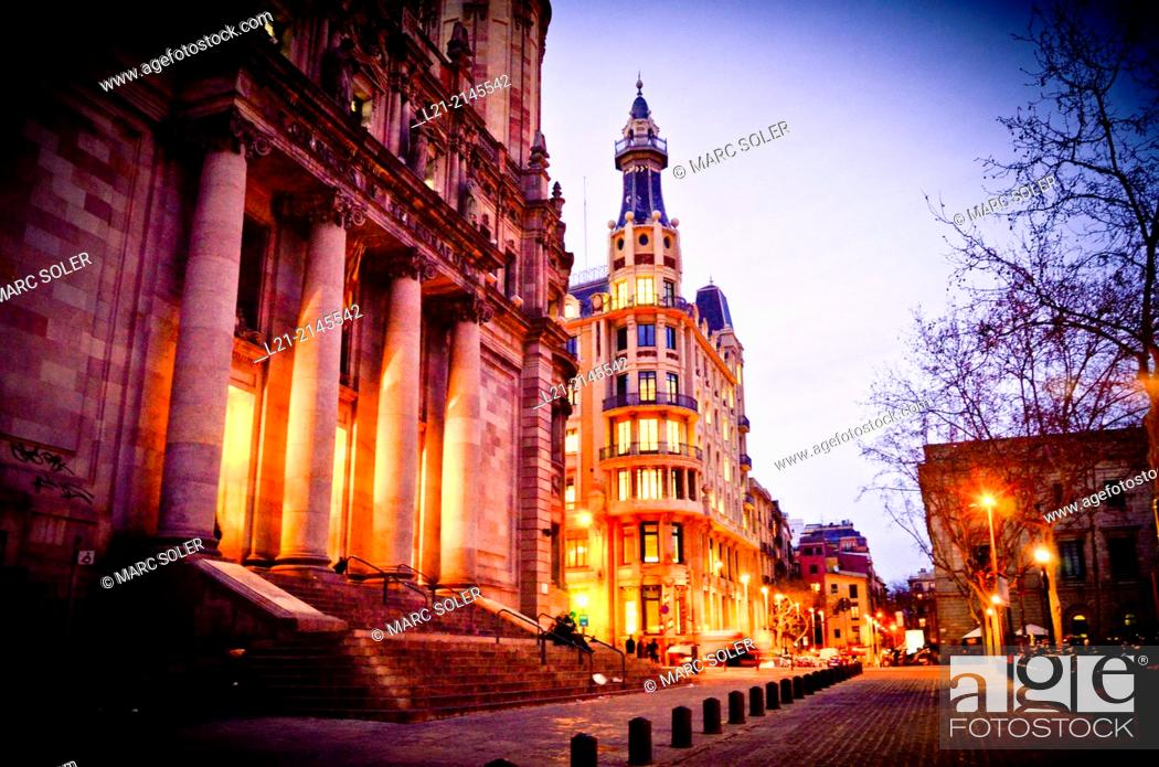 Stock Photo: View of central post office building designed by Josep Goday Casals and Jaume Torres Grau at dusk, night. Plaça Antonio López, Barcelona, Catalonia, Spain.