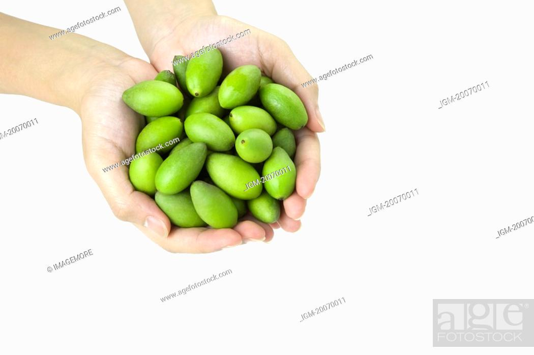 Stock Photo: Olives in hand.