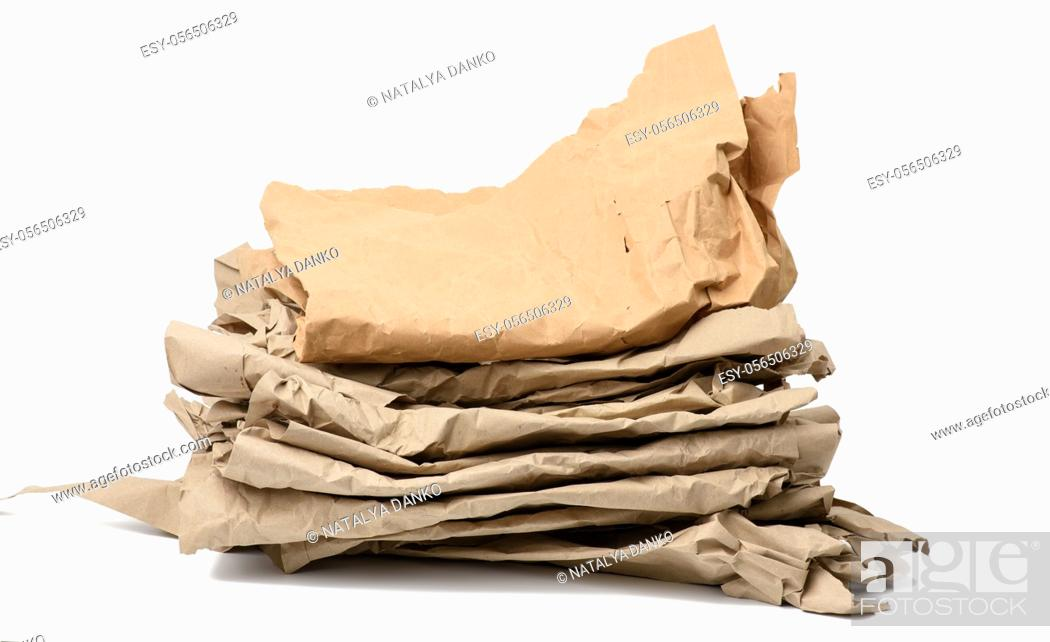 Stock Photo: piece of crumpled brown paper isolated on white background, element for designer, close up.