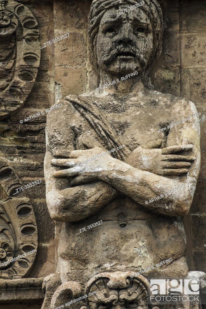 """Stock Photo: Detail of one of the """"""""Captive Moor"""""""" telamon sculptures on façade of the New Gate (Porta Nuova) as viewed from Independence Square (Piazza Indipendenza/Via."""