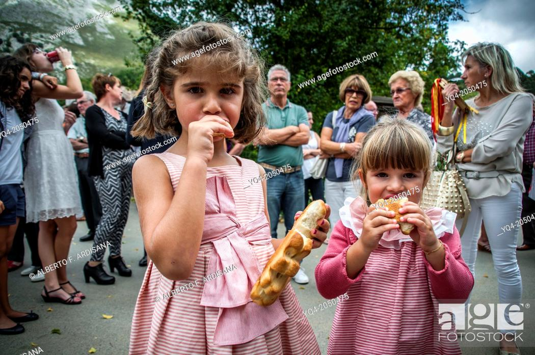 Stock Photo: These two young girls will eat traditional holiday breads. Llanes. Asturias. Spain.