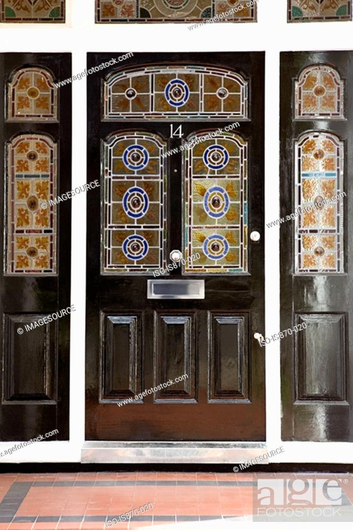 Stock Photo: Front door with stained glass windows.