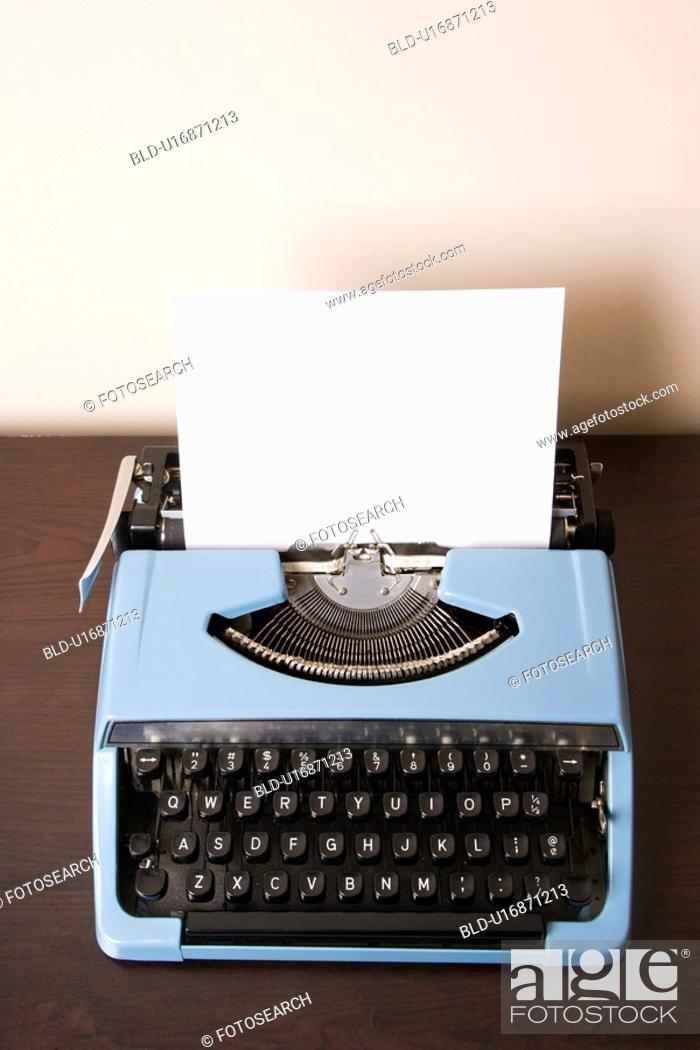 Stock Photo: Still life of blank sheet of paper in an old fashioned typewriter.