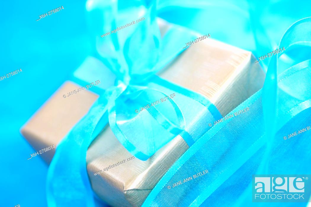 Stock Photo: special gift, gift wrapped with blue bow.