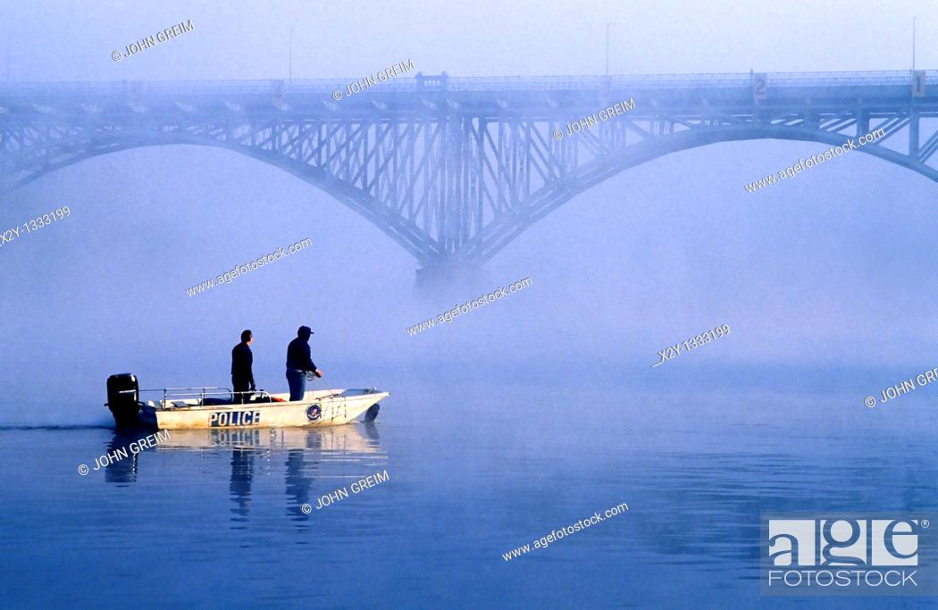 Stock Photo: Police boat searches for body in river.