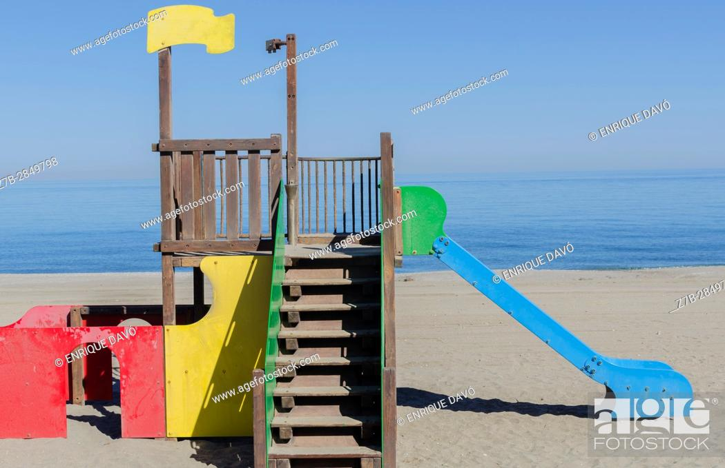 Stock Photo: A Mediterranean sea landscape view with a blue toboggan in Carboneras beach, Almería province, Spain.