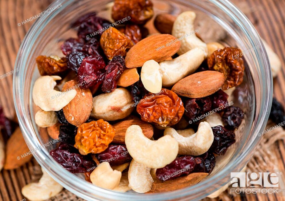 Stock Photo: Wooden table with Trail Mix (selective focus, close-up shot).