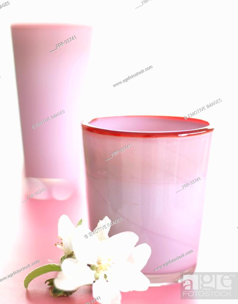 Stock Photo: Pale pink glass vases with spiderwort blossom.