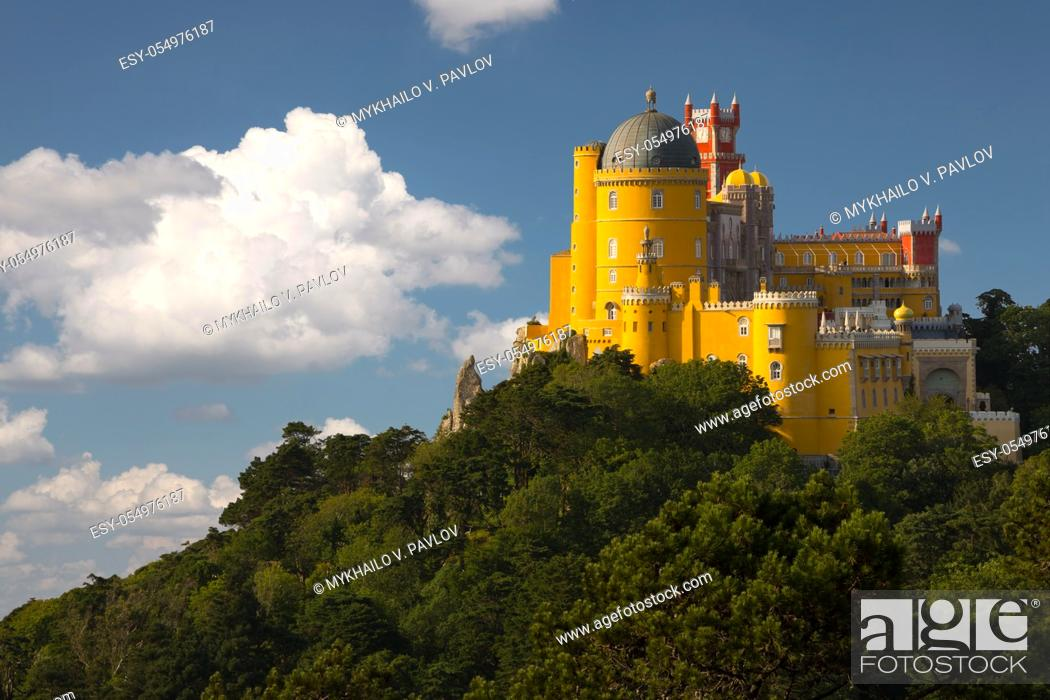 Stock Photo: Portugal. Sintra. The Pena Palace on a cliff surrounded by forest and clouds.