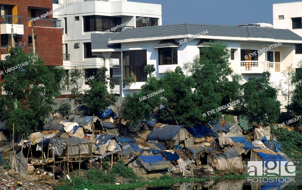 Stock Photo Slum Dwellings With Expensive Apartments Behind