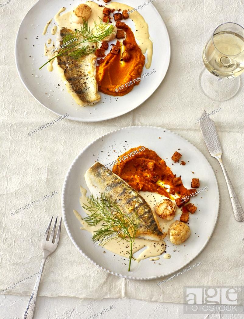 Stock Photo: Zander fillets and scallops with pumpkin puree (Christmas).
