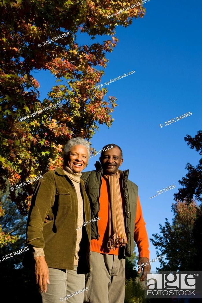 Stock Photo: Senior couple outdoors in autumn.